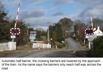 photograph of an automatic half barrier crossing